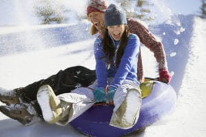 Friends Tubing --- Image by © Royalty-Free/Corbis